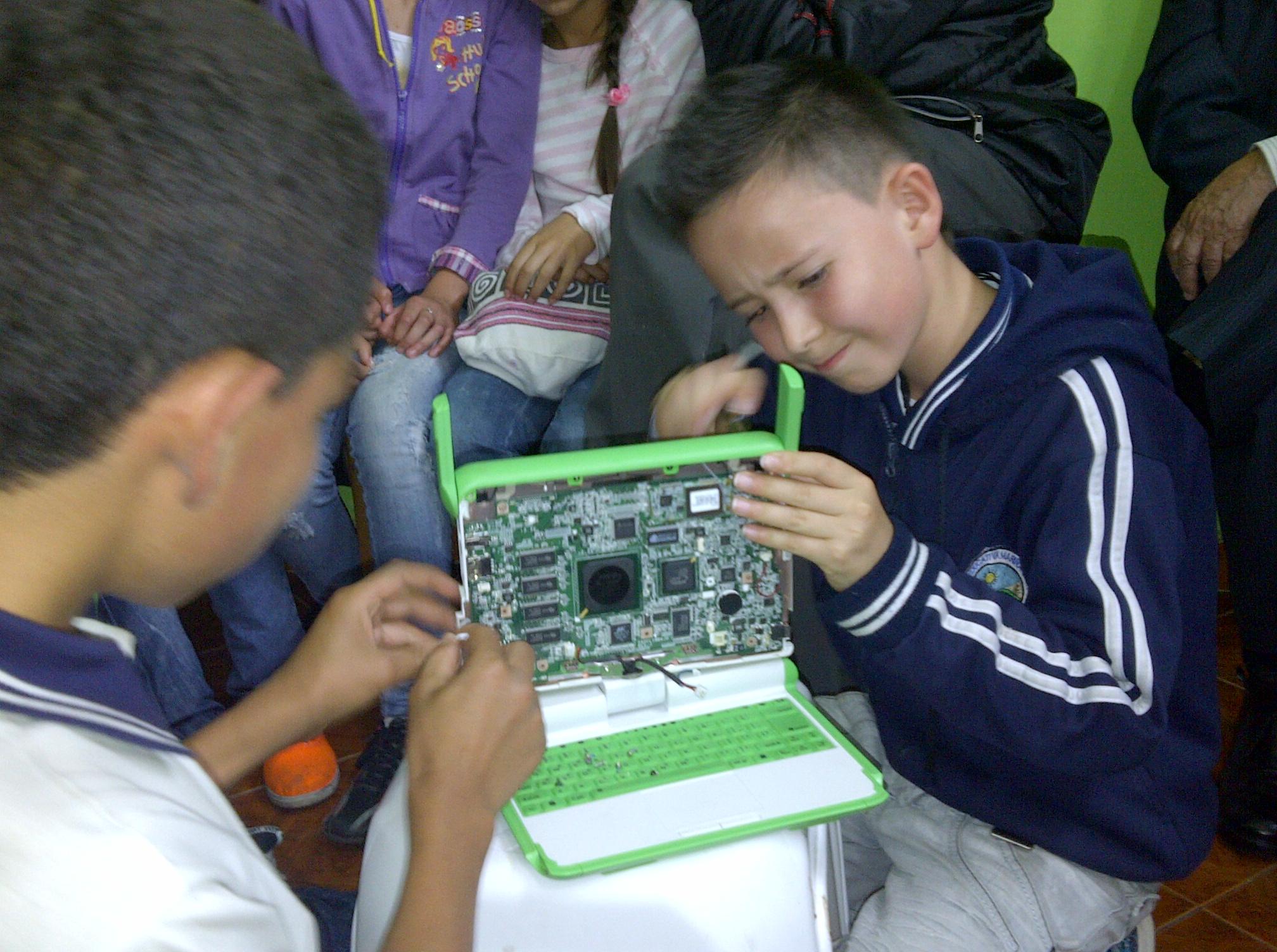 14 boys repairing computers